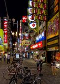 Brightly Lit Street With Numerous Billboards And Neons In Dotombori District, Osaka, Japan