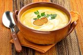 foto of butternut  - creamy carrot soup with croutons and parsley - JPG
