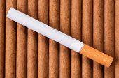 Cigarette With Brown Filter On Dark Cigarettes
