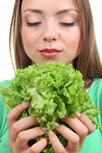 Beautiful girl with fresh lettuce, close up