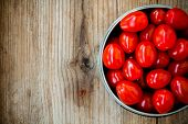 stock photo of boeuf  - Fresh red organic heirloom tomatoes on a wooden background