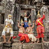SIEM REAP, CAMBODIA-MARCH 15, 2014:An unidentified cambodians in national dress poses for tourists i