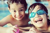 Children enjoying on pool