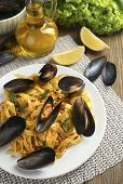 Traditional noodles with mussels on table, close up