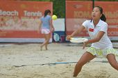 MOSCOW, RUSSIA - JULY 17, 2014: Fang Chunxue of China in the match against Belarus during ITF Beach Tennis World Team Championship. Belarus won the round 3-0