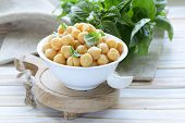fresh roasted chickpeas with basil leaves