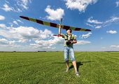 foto of glider  - Man launches into the sky RC glider wide - JPG