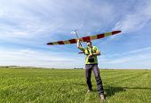 stock photo of glider  - Man launches into the sky RC glider wide - JPG