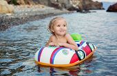 Happy Little Girl  Having Fun Bathing In Sea
