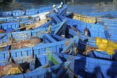 Blue fishing boats in Essaouira port, Atlantic coast, Morocco, Africa
