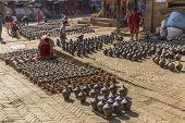 People Who Work Handcrafted Pottery On December 2, 2013 In Bhaktapur, Kathmandu Valley, Nepal