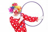 Male clown holding a hula hoop isolated on white background