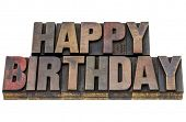 happy birthday - isolated text in vintage letterpress wood type stained by ink