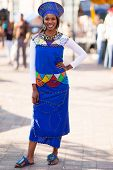 foto of traditional attire  - beautiful african woman in traditional attire in the city - JPG