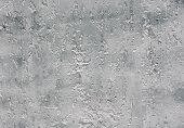 Grey rough plaster on wall
