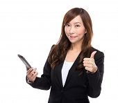 Asian businesswoman with cell phone and thumb up