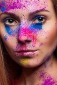 Woman With Color Powder On Face Fashion Make Up