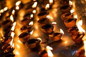 foto of diwali lamp  - Burning candles in the Indian temple - JPG