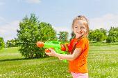 Nice girl playing with water gun