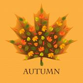 Autumn background with leaves laid out in the shape of a maple leaf