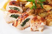 Stuffed chicken breast with roasted potato and lemon slices