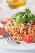 Italian fusilli pasta with basil and cherry tomato