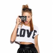 stock photo of love-making  - Pretty girl making photo using noname retro camera - JPG