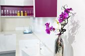 Nice kitchen interior with orchid flower