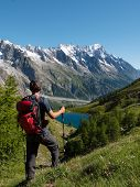 Hiker admiring mountain landscape in Val Veny, Mont Blanc, Courmayer, Italy, Europe.