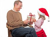 Child Presents gift to father