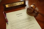 foto of contract  - Legal contract with gavel and Attorney name plate on a desk - JPG