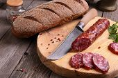 Salami, Bread And A Knife On The  Table