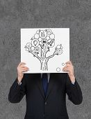 Businessman Holding Poster With Money Tree