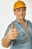 Worker In A Yellow Hardhat Showing Gesture Approval
