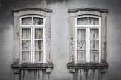 two old broken windows on the wall
