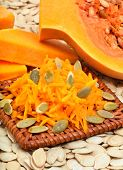 image of grating  - ripe raw pumpkin with grated pumpkin and pumpkin seeds background - JPG