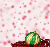 Christmas ball decoration on colored abstract background