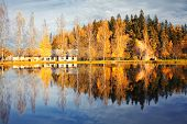 Hill With Trees With Reflection In Lake Autumn