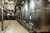 stock photo of fermentation  - Large volume stainless steel fermenters used to make wine - JPG