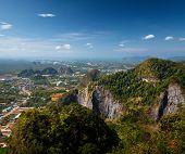 Valley with limestone mountains of the town of Krabi (on the horizon), Thailand
