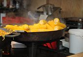 Cooking Roasted  Sweet Corn On Pan At Christmas Market