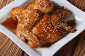 Chinese Chicken Wings Glazed With Sesame Seeds Close-up
