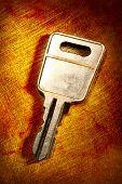 Metal Key On Iron Background