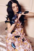 Portrait Of Beautiful Girl With Dark Hair With Butterflies