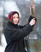 woman in winter clothes at  well