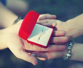 Love, Engagement And Wedding Concept - Hands Couple Holding A Box With A Ring Closeup
