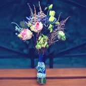 Wedding bride colorful stylish bouquet flowers outdoors