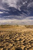Cloudy Blue Sky Above Parched Barren Land In Morocco