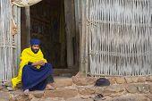 Priest sits at the church entrance, Bahir Dar, Ethiopia.