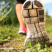 stock photo of crossed legs  - Walking or running exercise shoes close - JPG